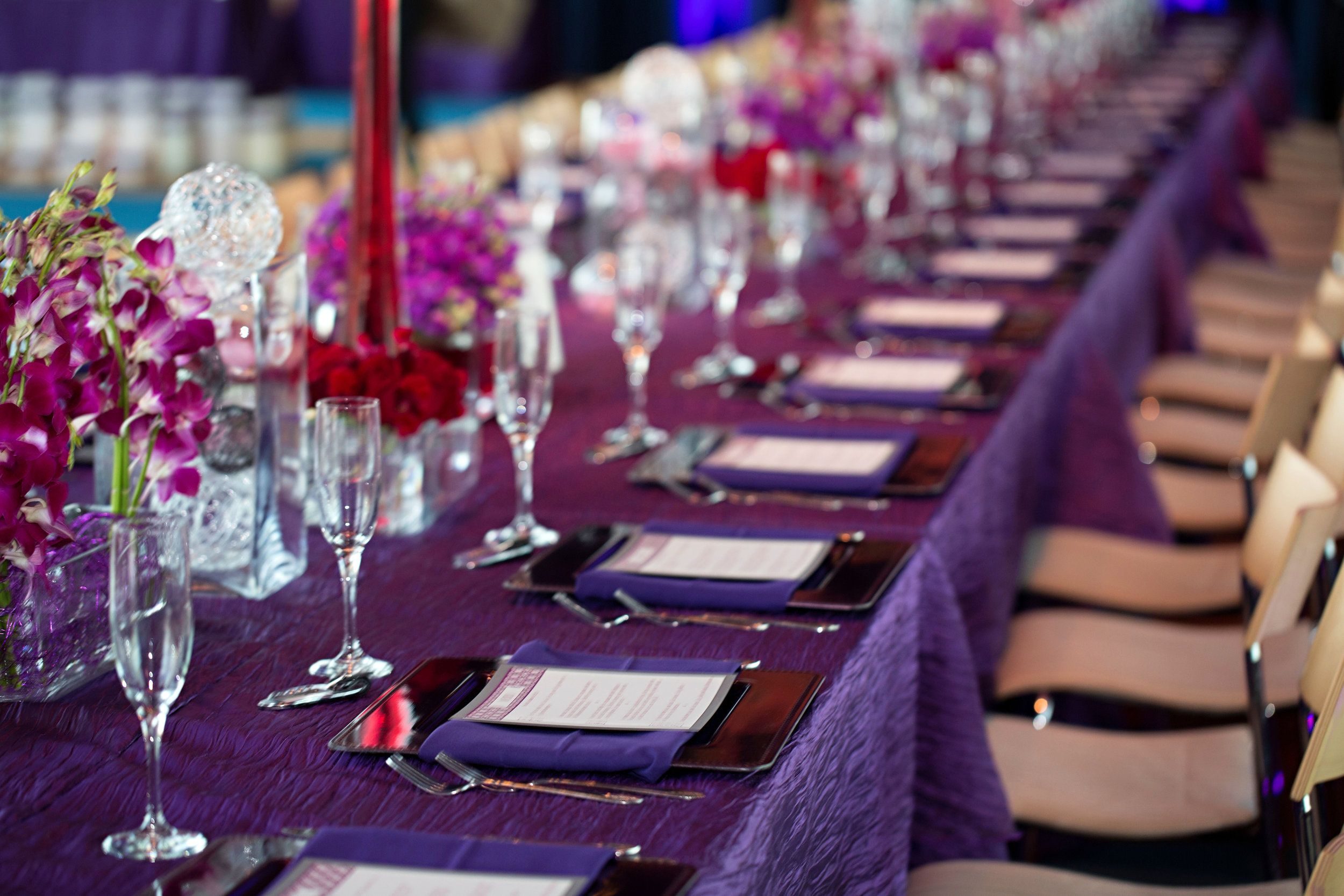 26 long reception tables purple floral centerpiece all purple reception tables O Grace Photography Life Design Events.jpg