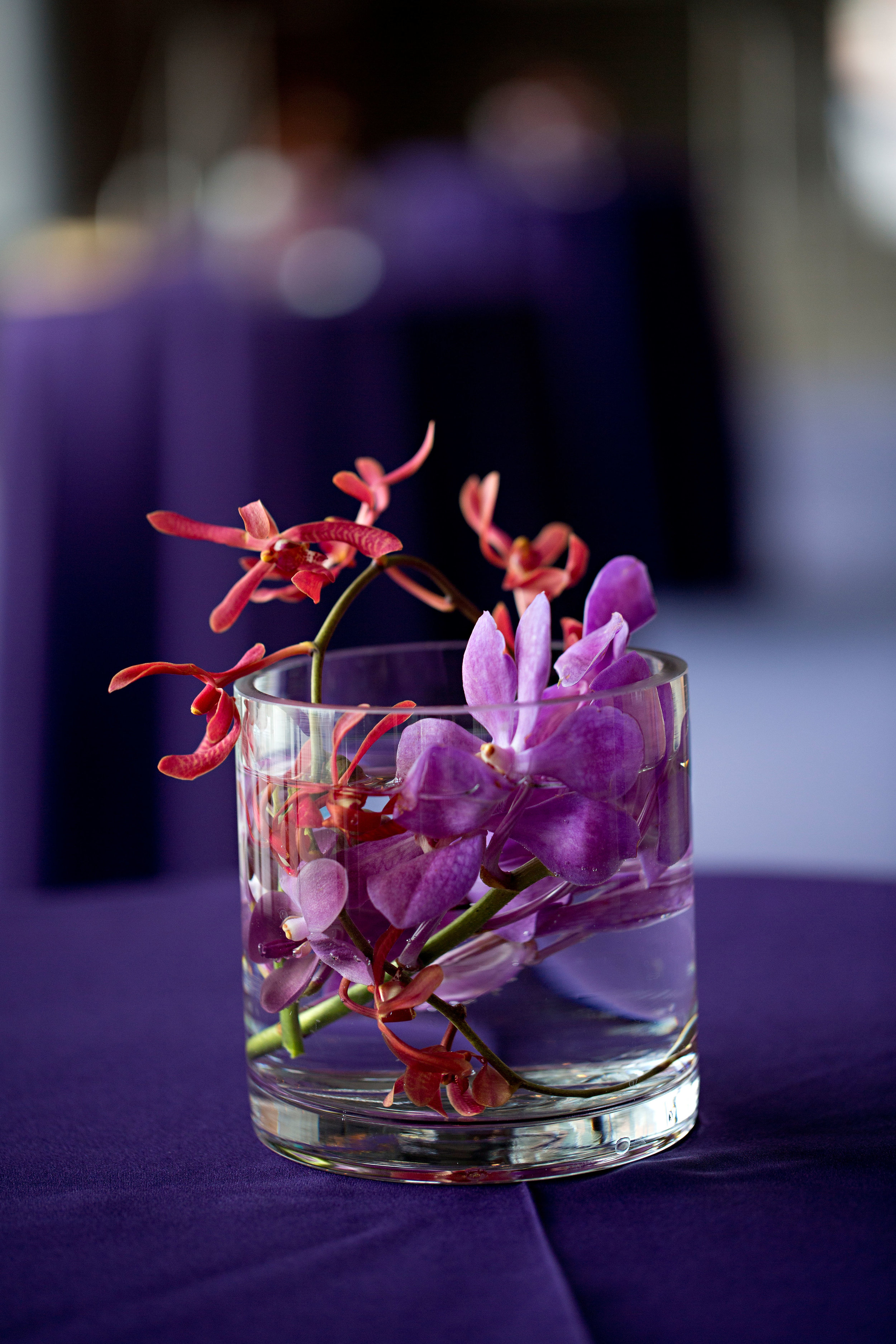 27 small centerpieces flowers in a whiskey glass whiskey glass centerpieces O Grace Photography Life Design Events.jpg