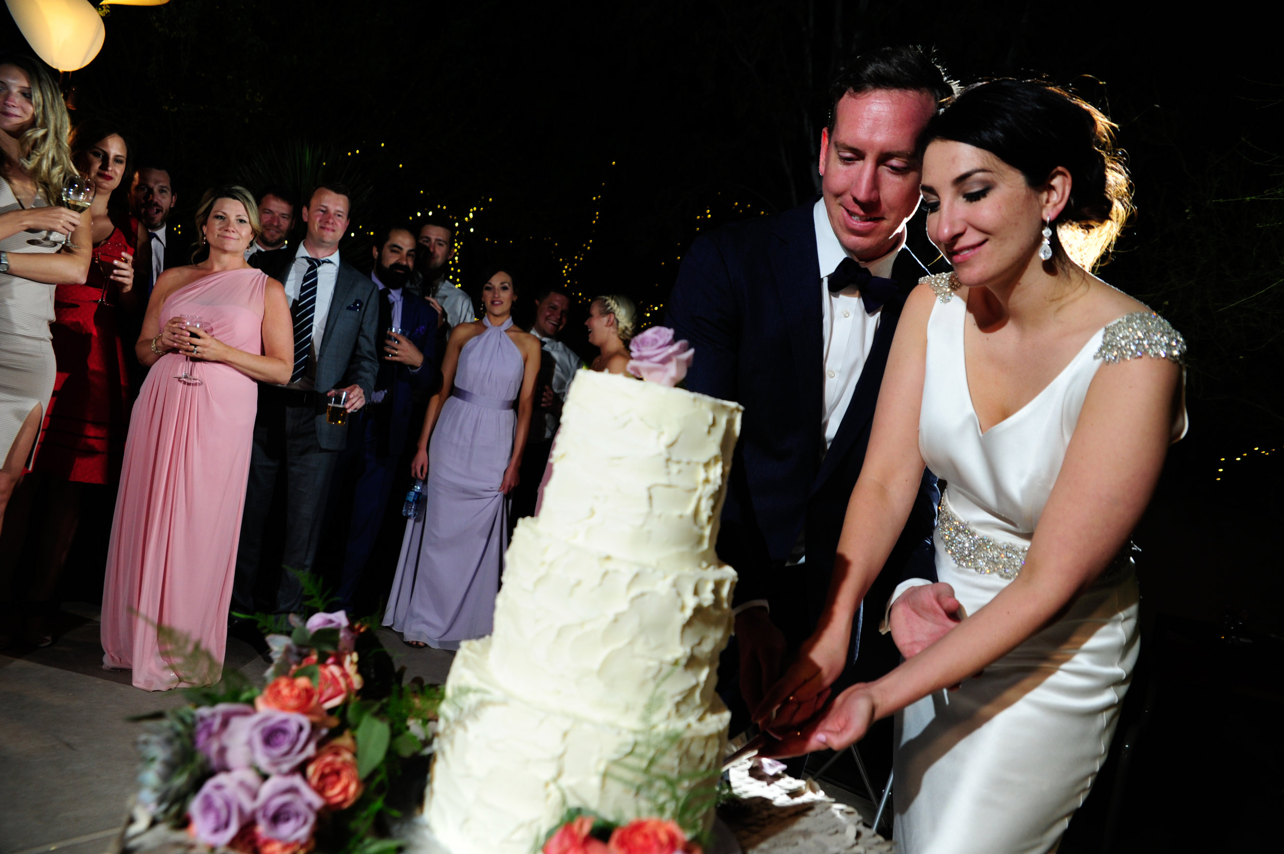 36 bride and groom cutting the cake simple wedding cake plain wedding cake all white wedding cake Mod Wed photography Life Design Events.jpg