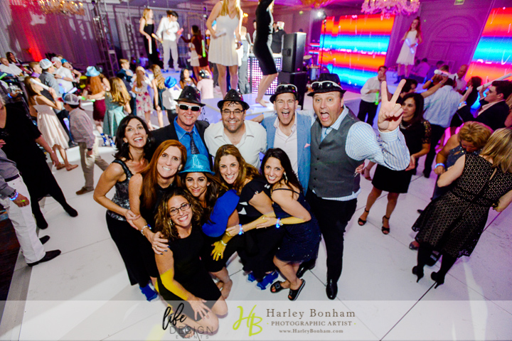 33a all the guest on the dance floor guest at bar mitzvah dancing candid photos at bar mitzvah guest having fun guest dancing at bar mitzvah all white dance floor large dance floor Harley Bonham Photography Life Design Events.jpg