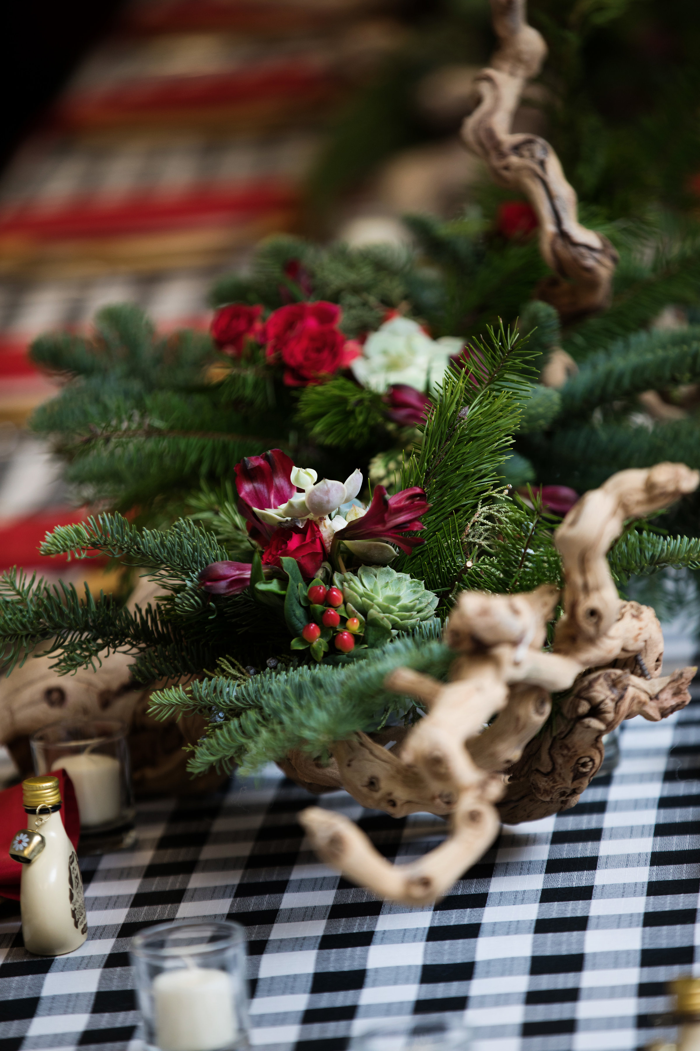 1 christmas party christmas dinner red and green centerpieces red rose succulent driftwood centerpieces black and white checkered linen family dinner staff dinner Life Design Events photos by Largo Photography.jpg