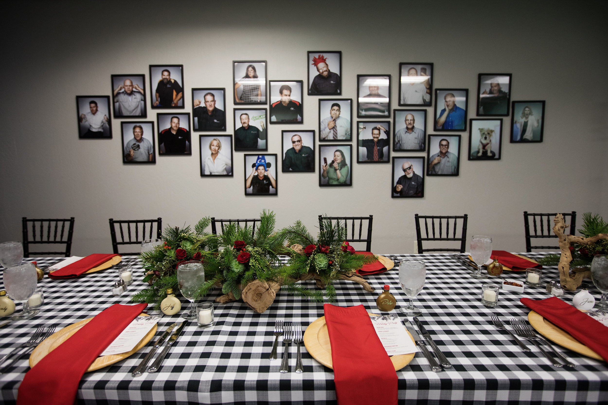 3 staff photo wooden charger chiavari chair christmas party christmas dinner red and green centerpieces red rose succulent driftwood centerpieces black and white checkered linen family dinner staff dinner Life Design Events photos by Largo Photography.jpg