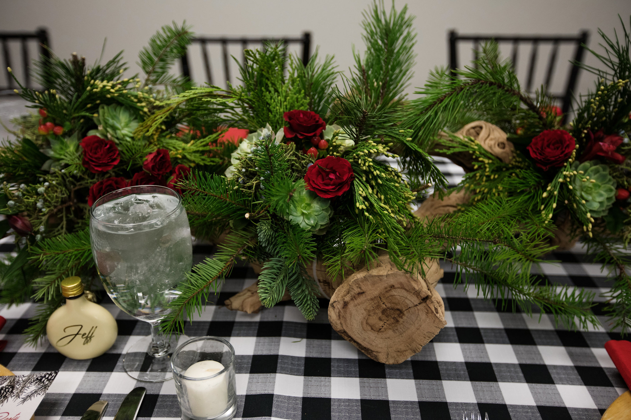 4 holiday centerpiece chiavari chair christmas party christmas dinner red and green centerpieces red rose succulent driftwood centerpieces black and white checkered linen family dinner staff dinner Life Design Events photos by Largo Photography.jpg