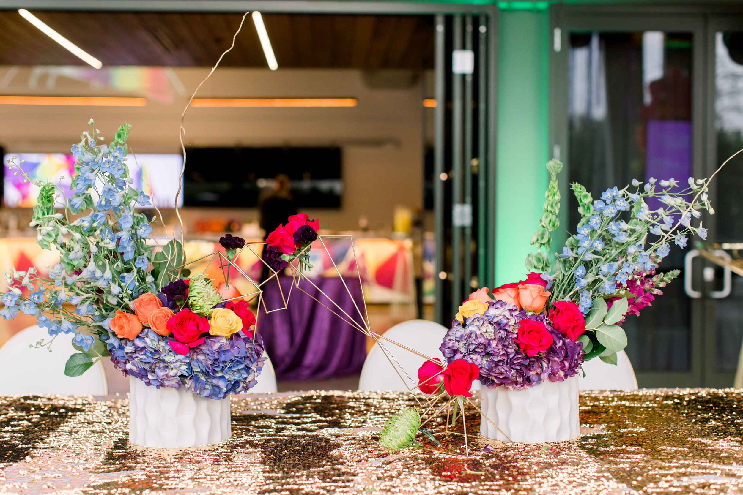 12 rainbow flowers geometric centerpieces gold shape flower centerpiece gold mermaid sequin table cloth Life Design Events photos by Stephanie Heymann Photography.jpg