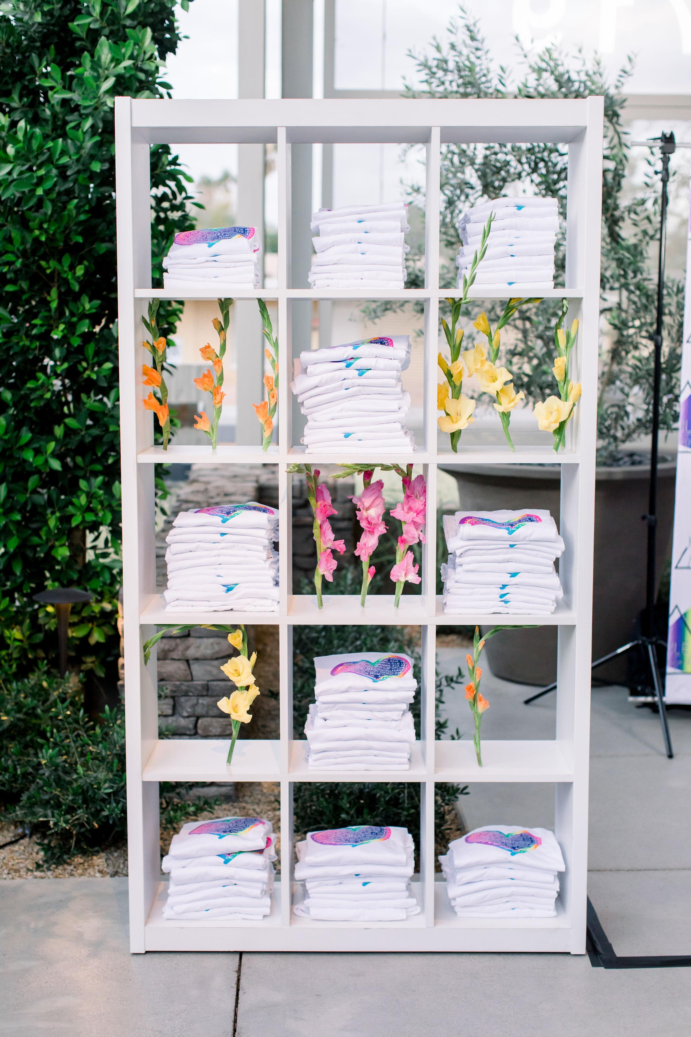 16 bud vases rainbow flowers folded tshirts custom designed tshirts bat mitzvah party Life Design Events photos by Stephanie Heymann Photography.jpg