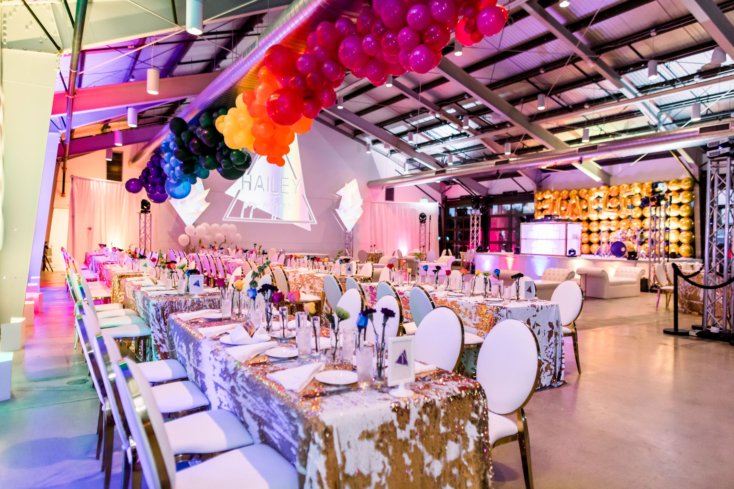 21 rainbow bat mitzvah party room reception dinner tables mermaid sequin table linen rainbow balloon garland custom light projection Life Design Events photos by Stephanie Heymann Photography.jpg