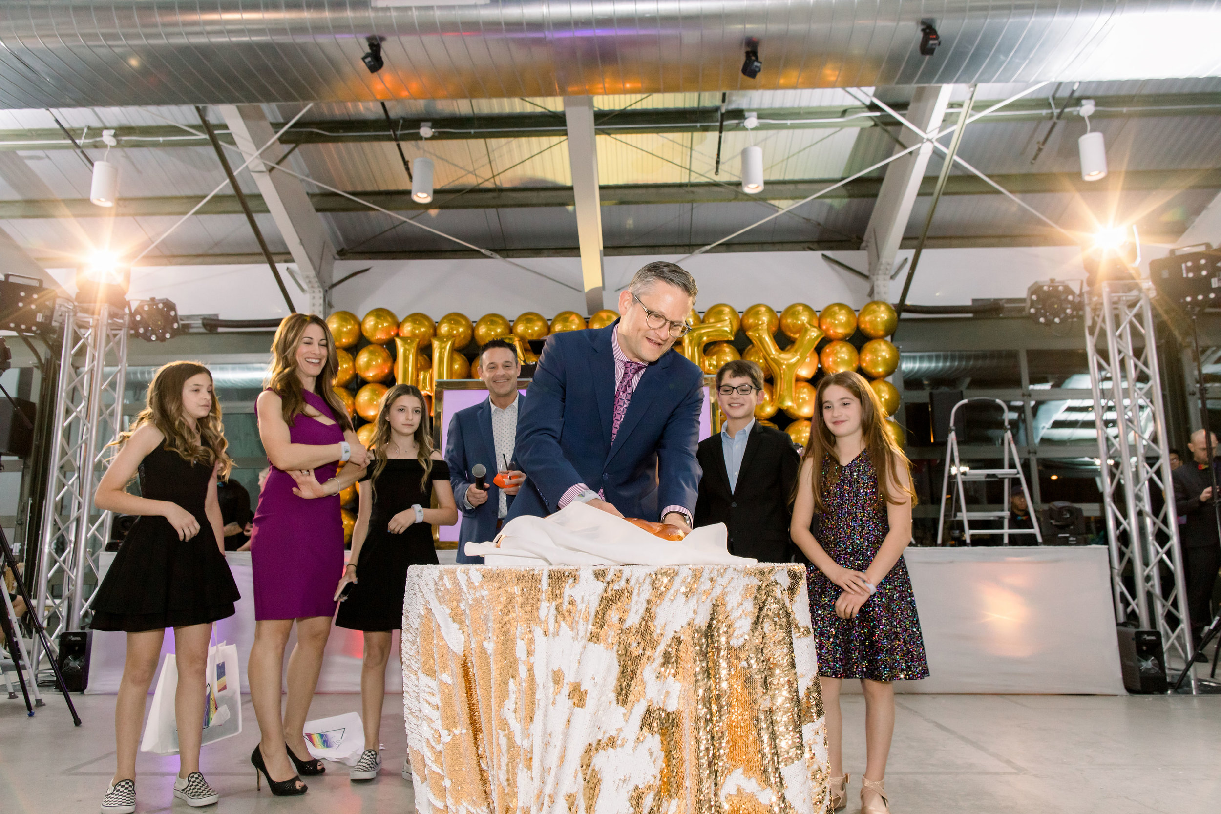 36 rainbow bat mitzvah blessing challah bread blessing jewish tradition gold mermaid sequin table linen gold balloon wall backdrop Life Design Events photos by Stephanie Heymann Photography.jpg