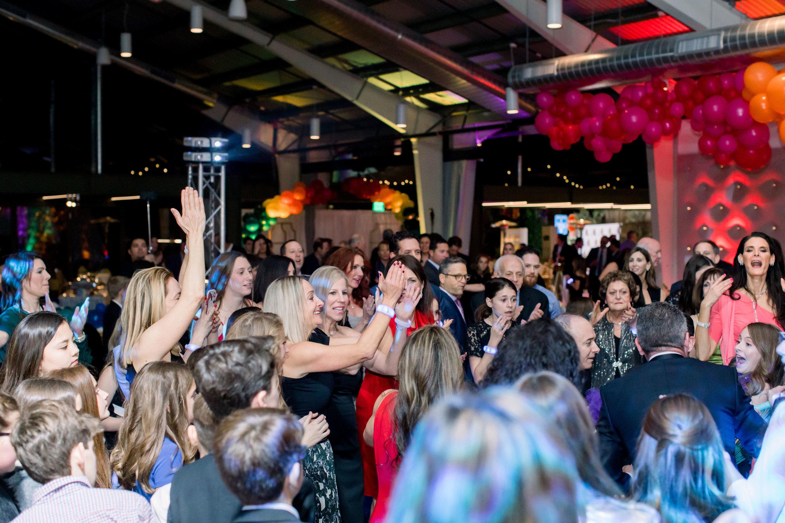 37 rainbow bat mitzvah dance party guests dance hora lift chair Life Design Events photos by Stephanie Heymann Photography.jpg