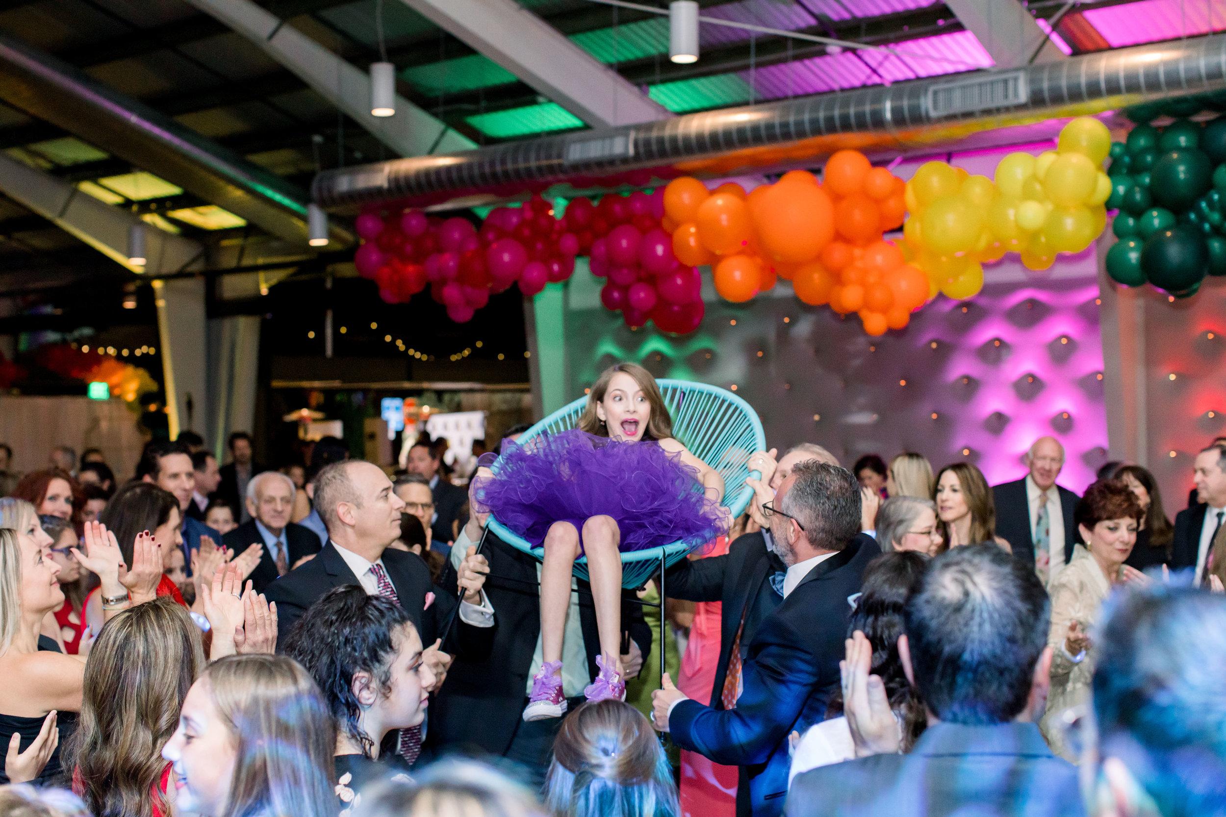 38 bat mitzvah girl lift in chair hora dance hava nagila surprised girl purple tulle skirt bat mitzvah dance tradition Life Design Events photos by Stephanie Heymann Photography.jpg