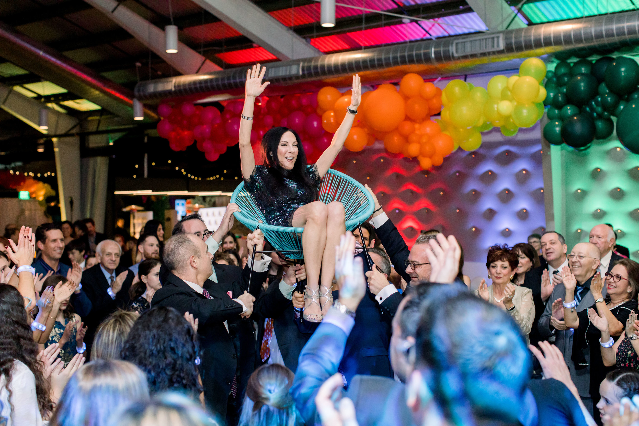 39 rainbow bat mitzvah mom lifted in chair hora dance tradition bat mitzvah dance party Life Design Events photos by Stephanie Heymann Photography.jpg