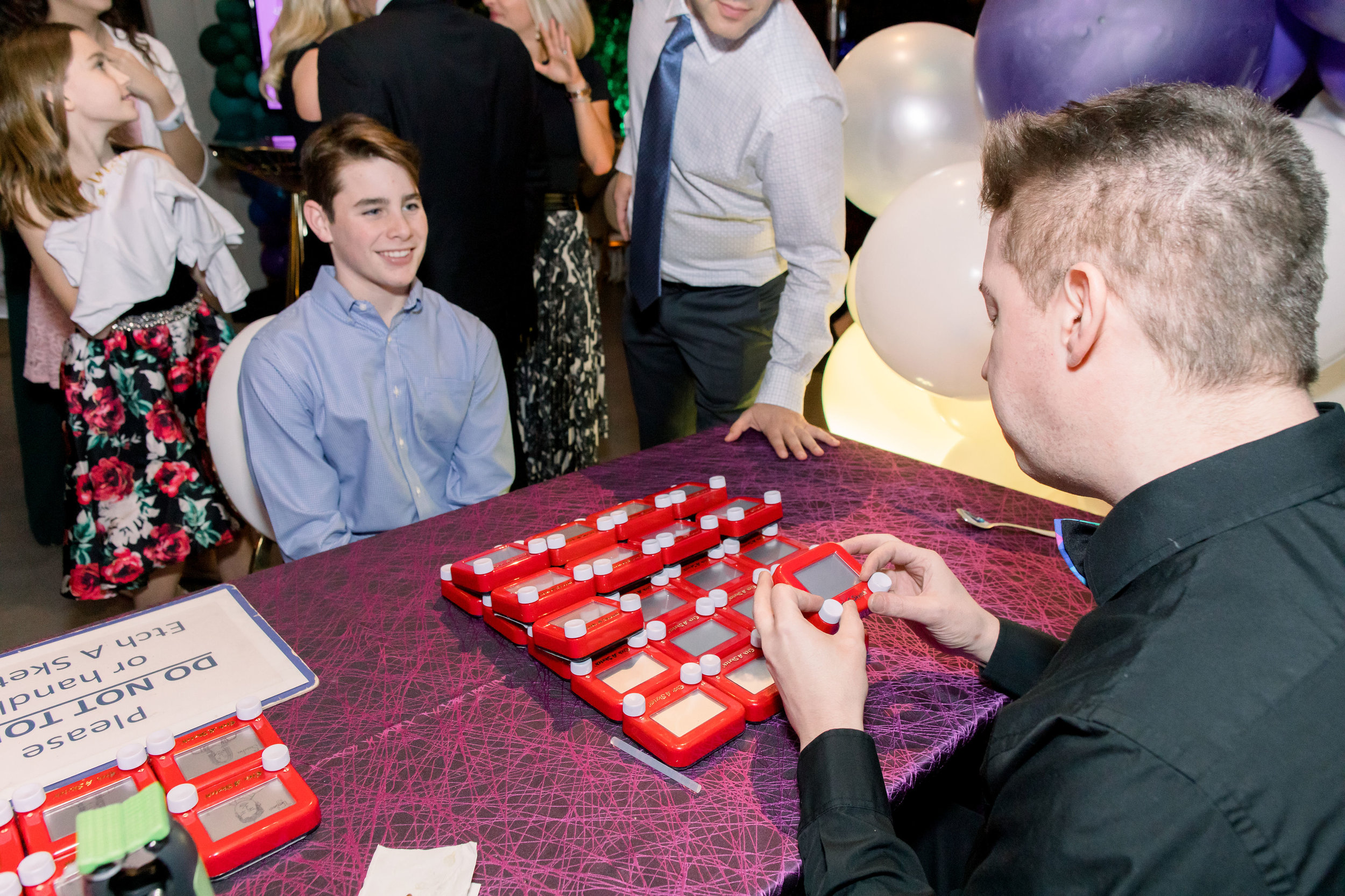 51 bat mitzvah party entertainment etch a sketch drawings etch u pose for a picture portrait on etch a sketch Life Design Events photos by Stephanie Heymann Photography.jpg