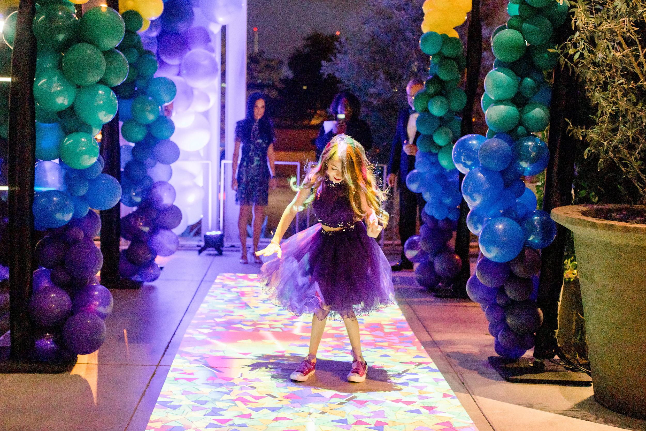 54 rainbow bat mitzvah party rainbow balloon columns custom interactive light projection game purple tulle skirt bat mitzvah entertainment Life Design Events photos by Stephanie Heymann Photography.jpg