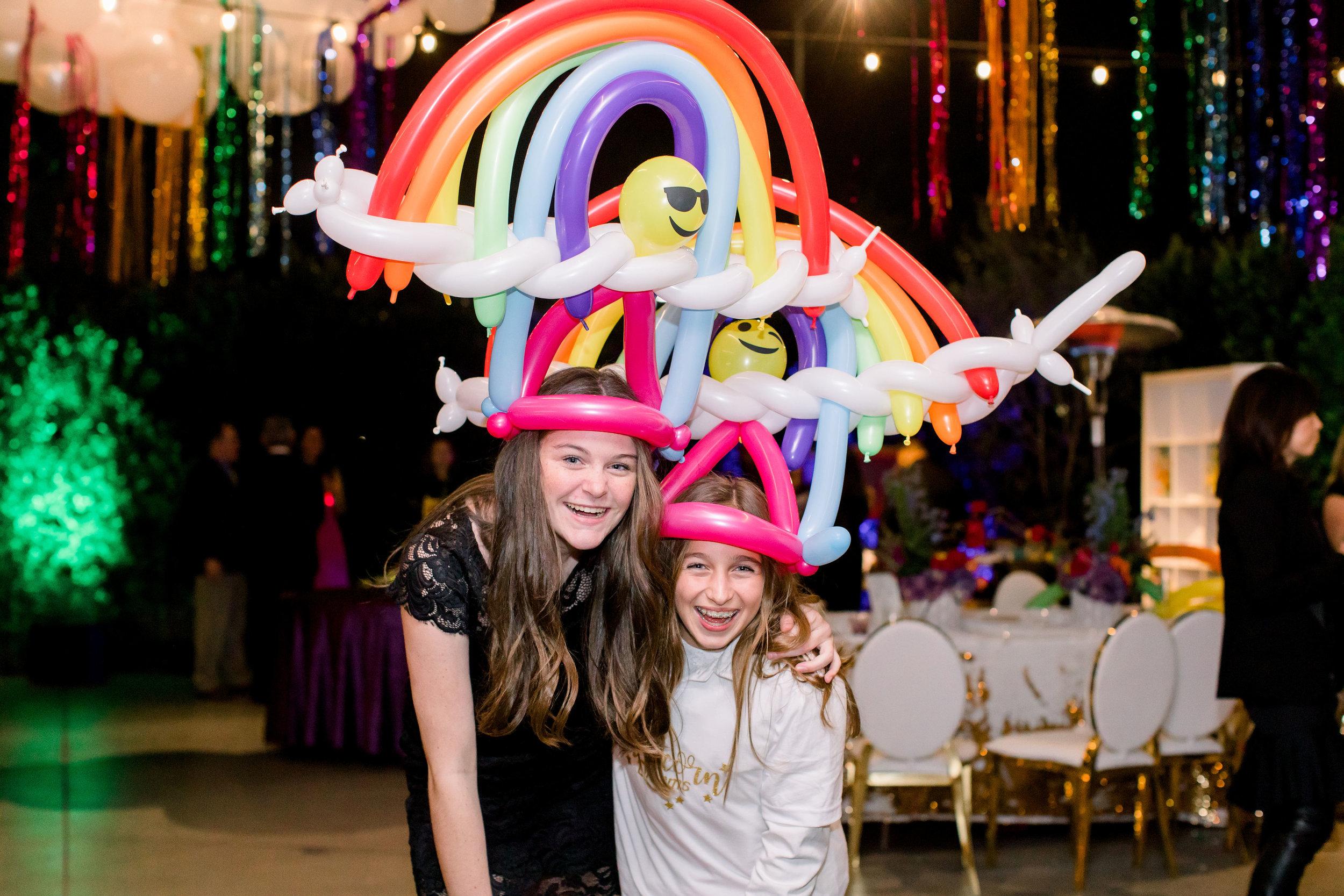 58 rainbow balloon hat custom balloon creation balloon twister rainbow bat mitzvah party entertainment Life Design Events photos by Stephanie Heymann Photography.jpg