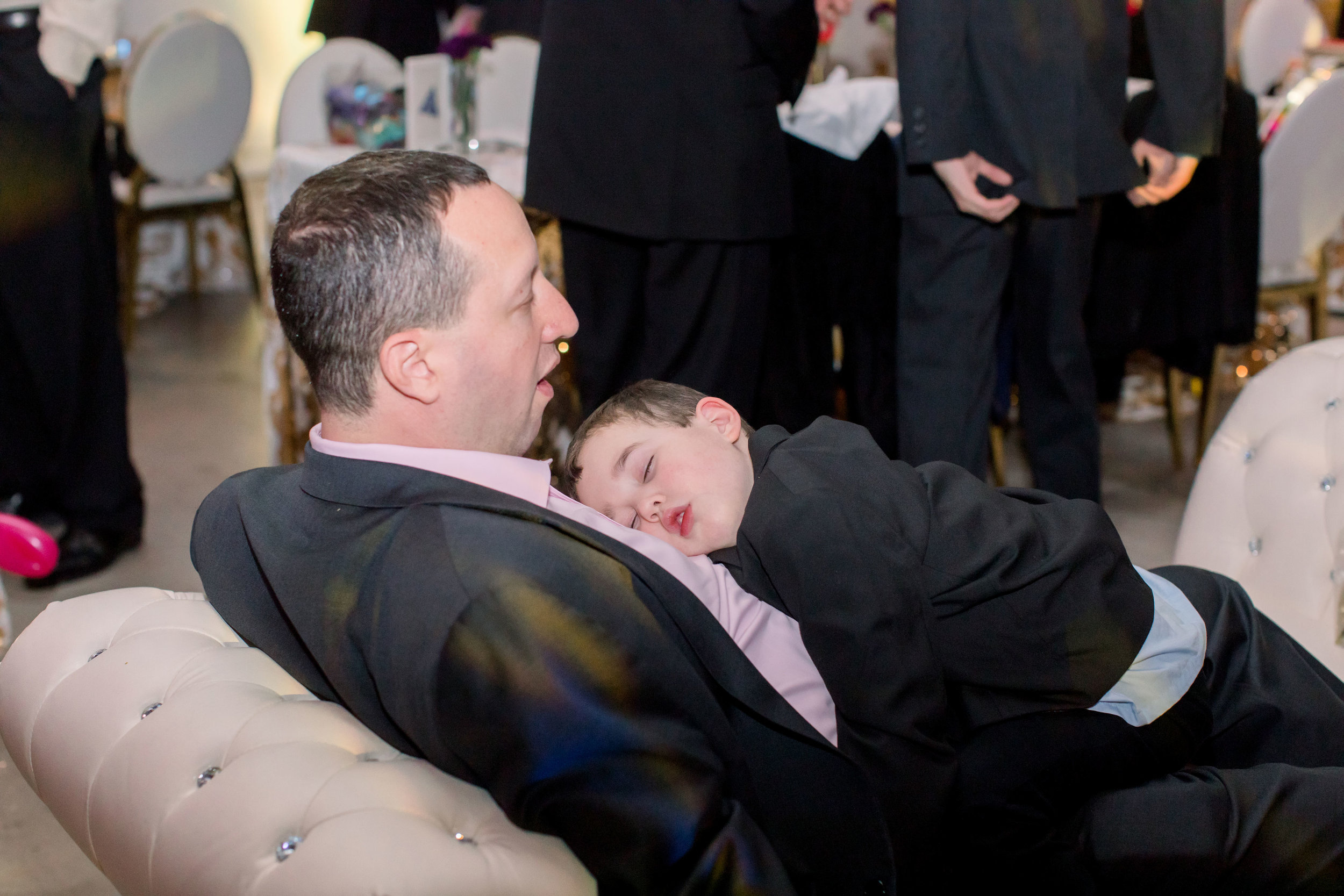 62 rainbow bat mitzvah tired party guest fell asleep at party tired party boy Life Design Events photos by Stephanie Heymann Photography.jpg