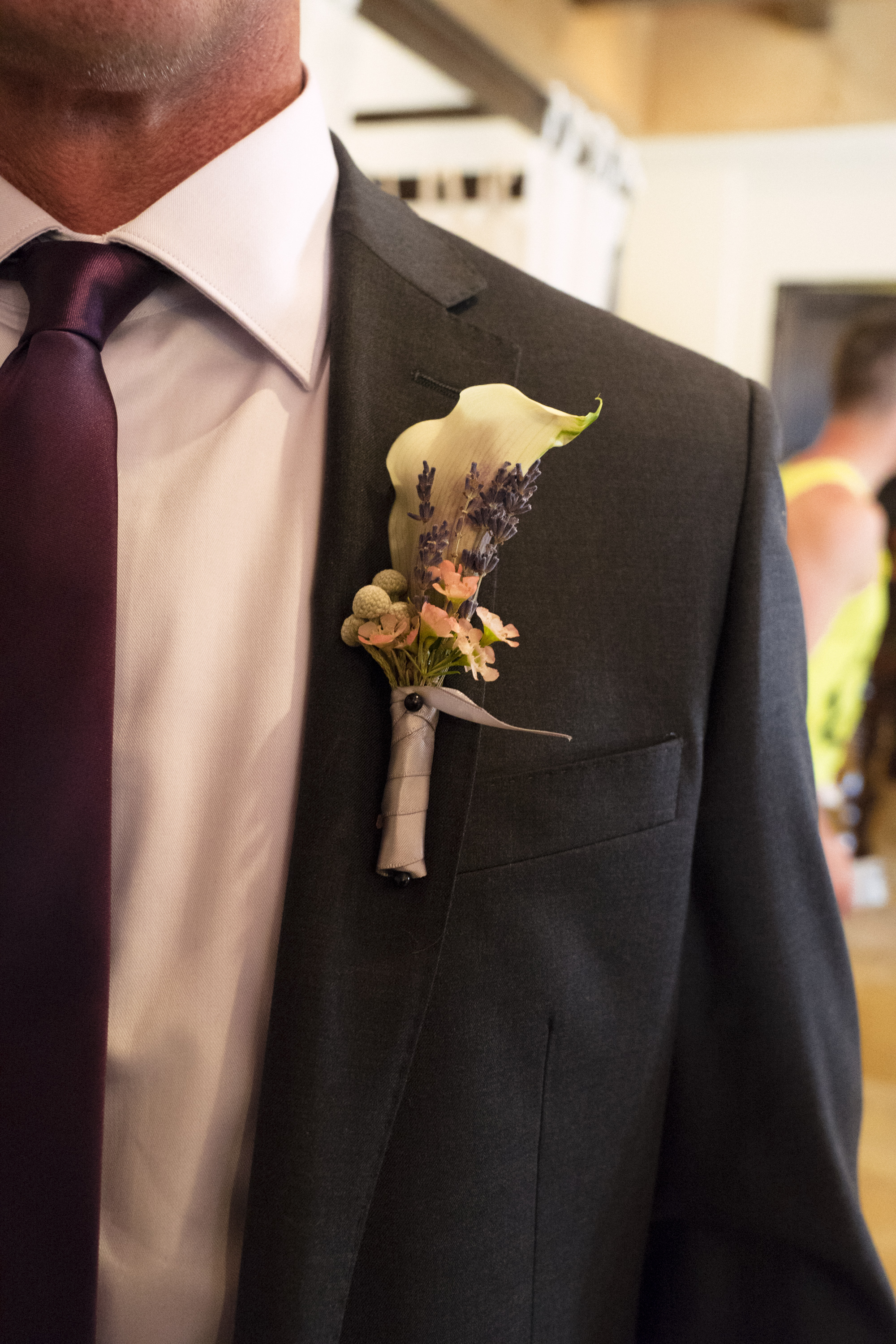 3 purple boutonniere Life Design Events photos by Keith and Melissa Photography.jpg