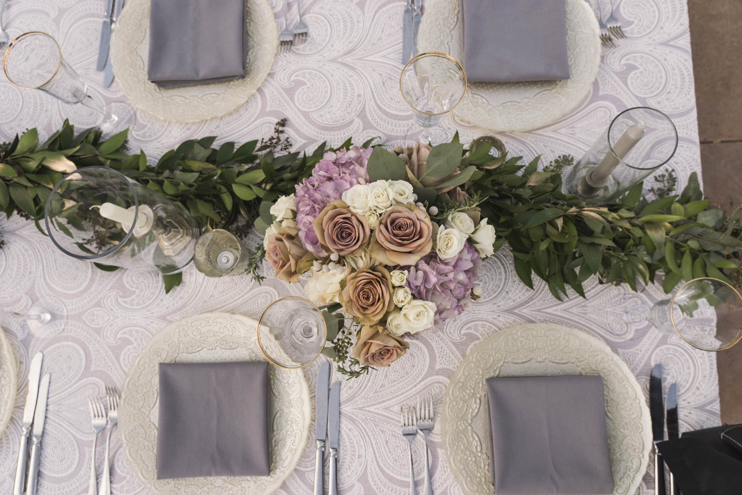 7 white rose purple hydrangea centerpiece greens garland purple place setting dinner table lace linen Life Design Events photos by Keith and Melissa Photography.jpg