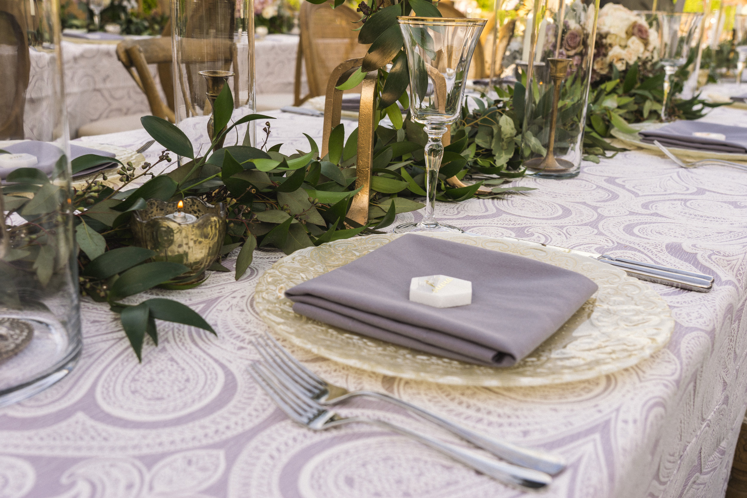9 place setting dinner table purple napkin candlelight dinner placecard tile Life Design Events photos by Keith and Melissa Photography.jpg