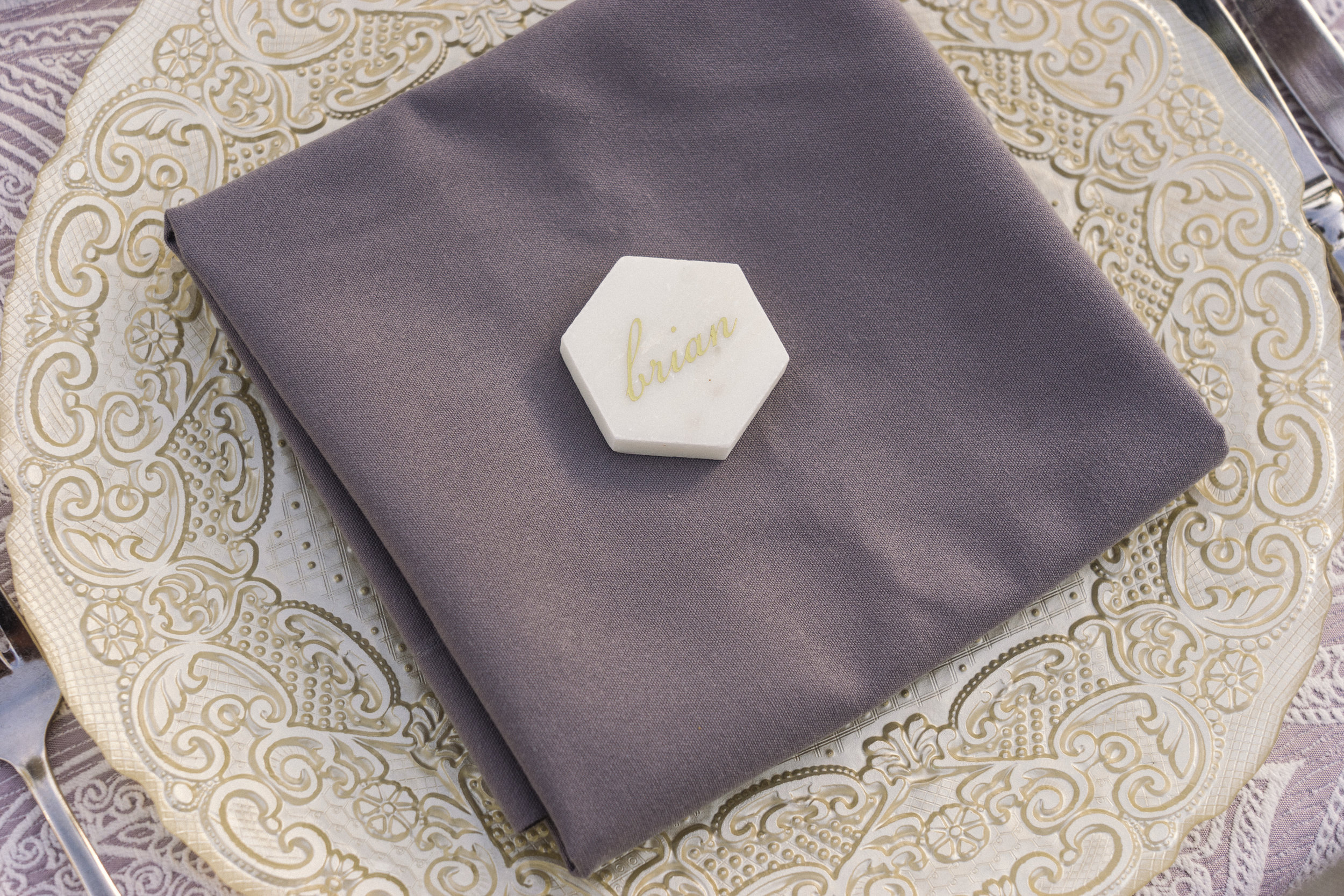 10 gold charger purple linen napkin tile placecard dinner table assigned seats Life Design Events photos by Keith and Melissa Photography.jpg