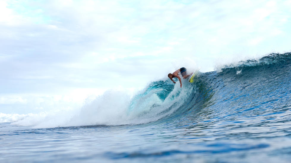 Mick Fanning dips his fins in the waters at Teahupo'o. Photo c/o WSL and Kelly Cestari