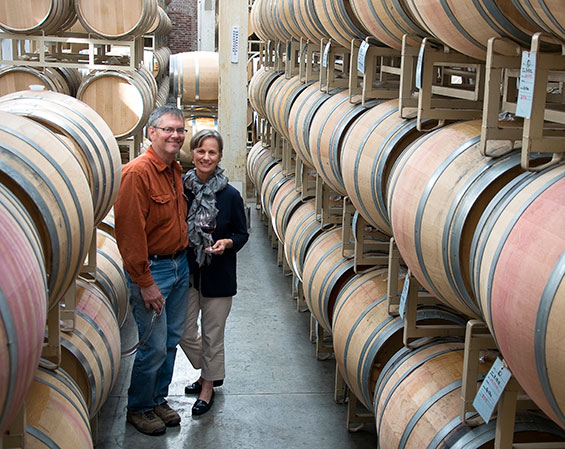 Owners of Seven Hills winery, in their barrel room.