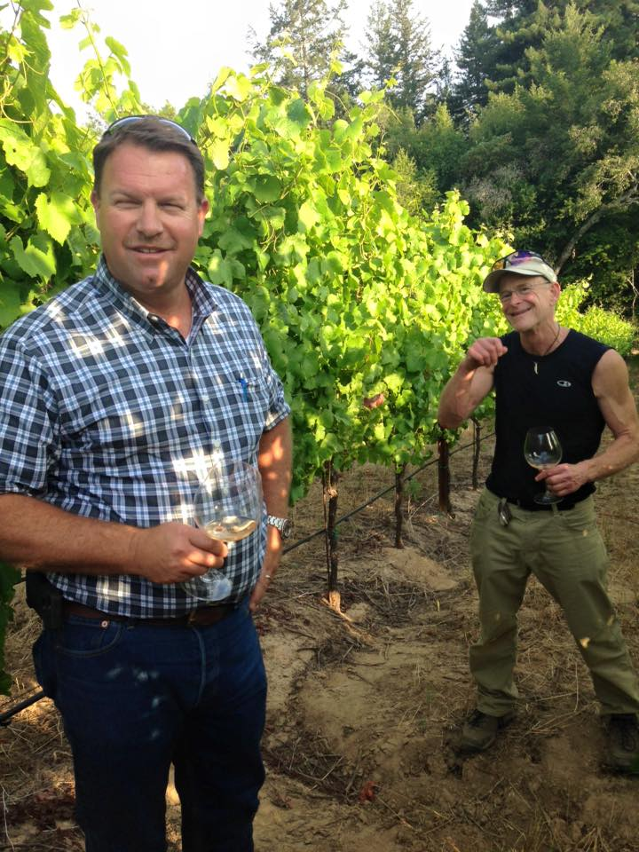 Steve Dutton and Dan Goldfield sampling some Chardonnay in their vineyard