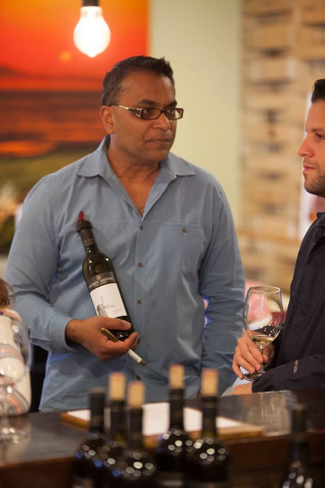 Dr. Kit Singh, dentist, and head winemaker at Lauren Ashton Cellars, pouring some wine at his event. His new releases were highly impressive.