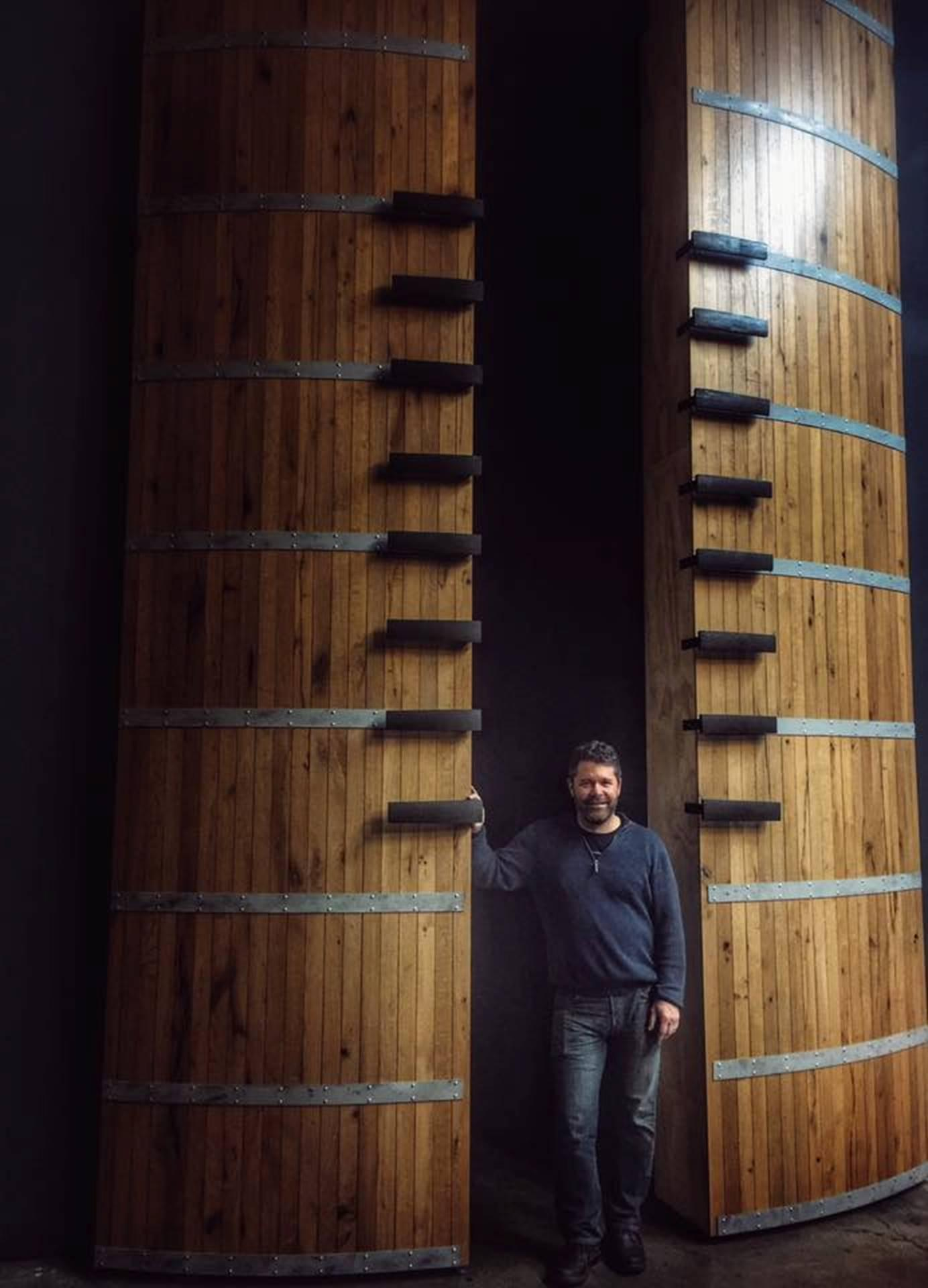 Chris Peterson, pictured in the Passing Time winery with their distinctive football-themed backdrop