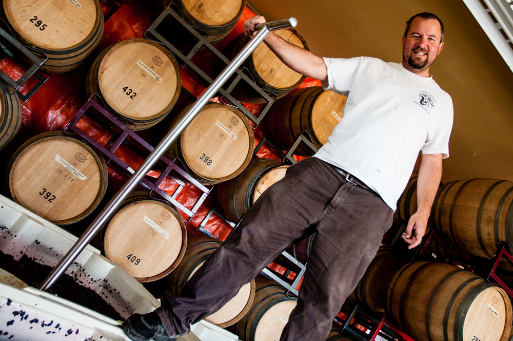 Sean Boyd, pictured here in his barrel room, is the owner and head winemaker at Rotie Cellars