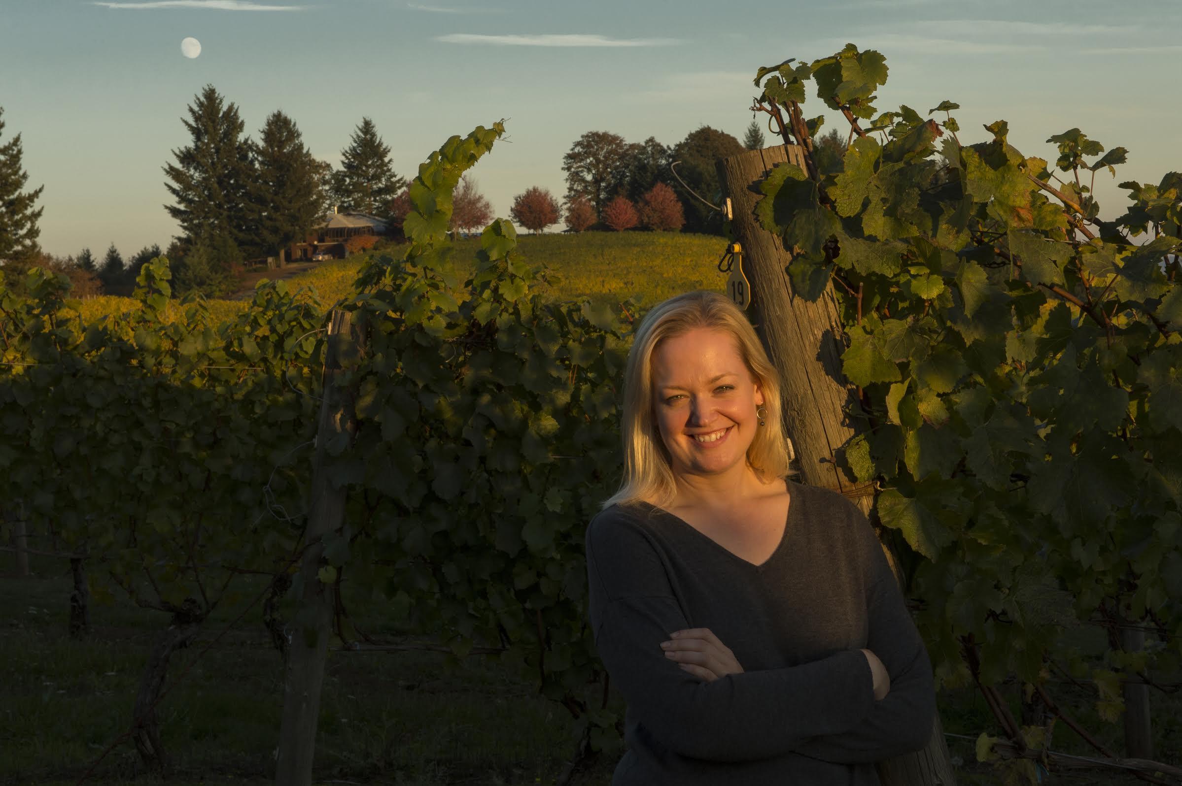 Great photo of Kim Kramer, head winemaker of Kramer Vineyards, in her estate vineyards.