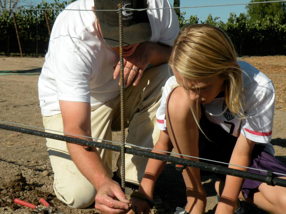 Cool photo here of Joey Tensley with his son Oliver, planting some Syrah