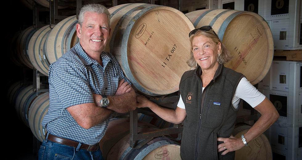 Great photo here of Randy and Debbie Lewis in their Lewis Cellars barrel room.