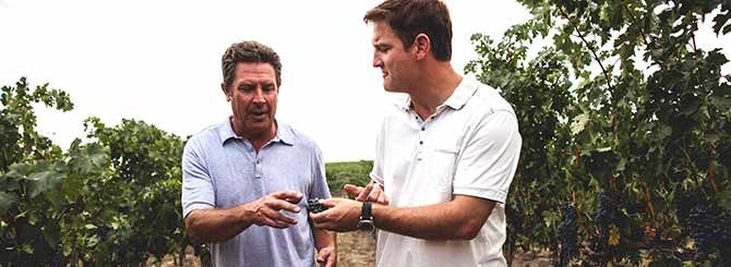 Great photo here of NFL legends, Dan Marino (L) and Damon Huard (R) in the vineyard.
