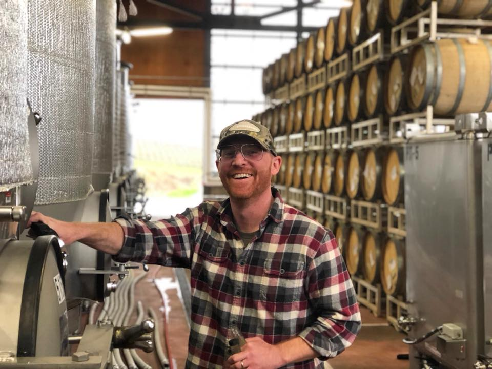 Great photo here of Gran Moraine winemaker, Shane Moore, sampling some Chardonnay out of the tank.