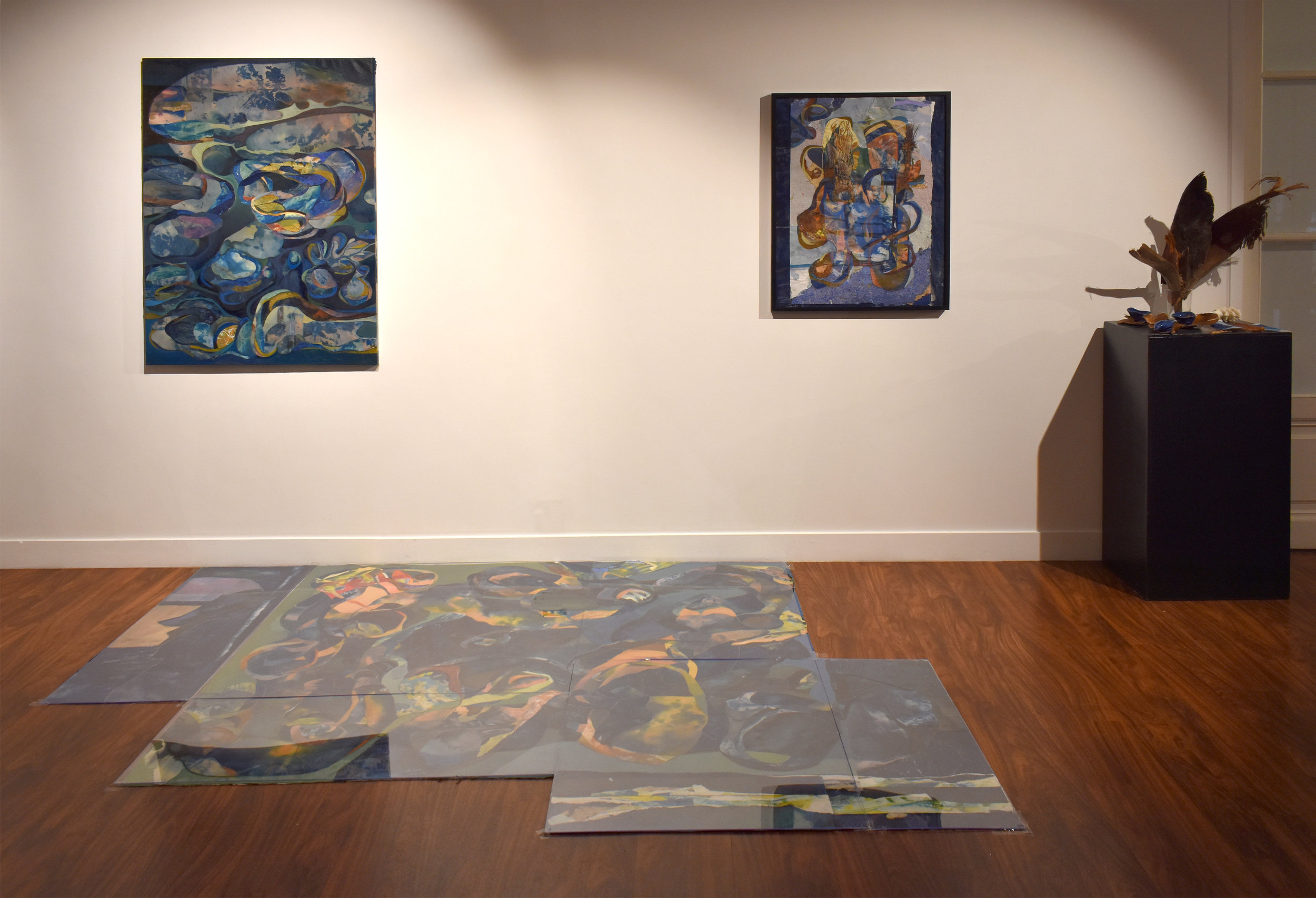 INSTALLATION:   Unfurled  as a floor installation   under plexiglass, along with  Looped  (left) and  Study for Unfurled  (right) and  Altar for Unfurled  : revealing the natural materials (palm tree bark, platycerium leaves, Icelandic rock, hand-made ceramic vessels, cyanotypes of the human cerebellum) that inspired/generated the painting. The choice of a floor composition presents the three works as a continuous, cyclical whole— a stage in the process of recycling paintings and natural materials. Floor composition inspired by Italian mineral marqueterie.