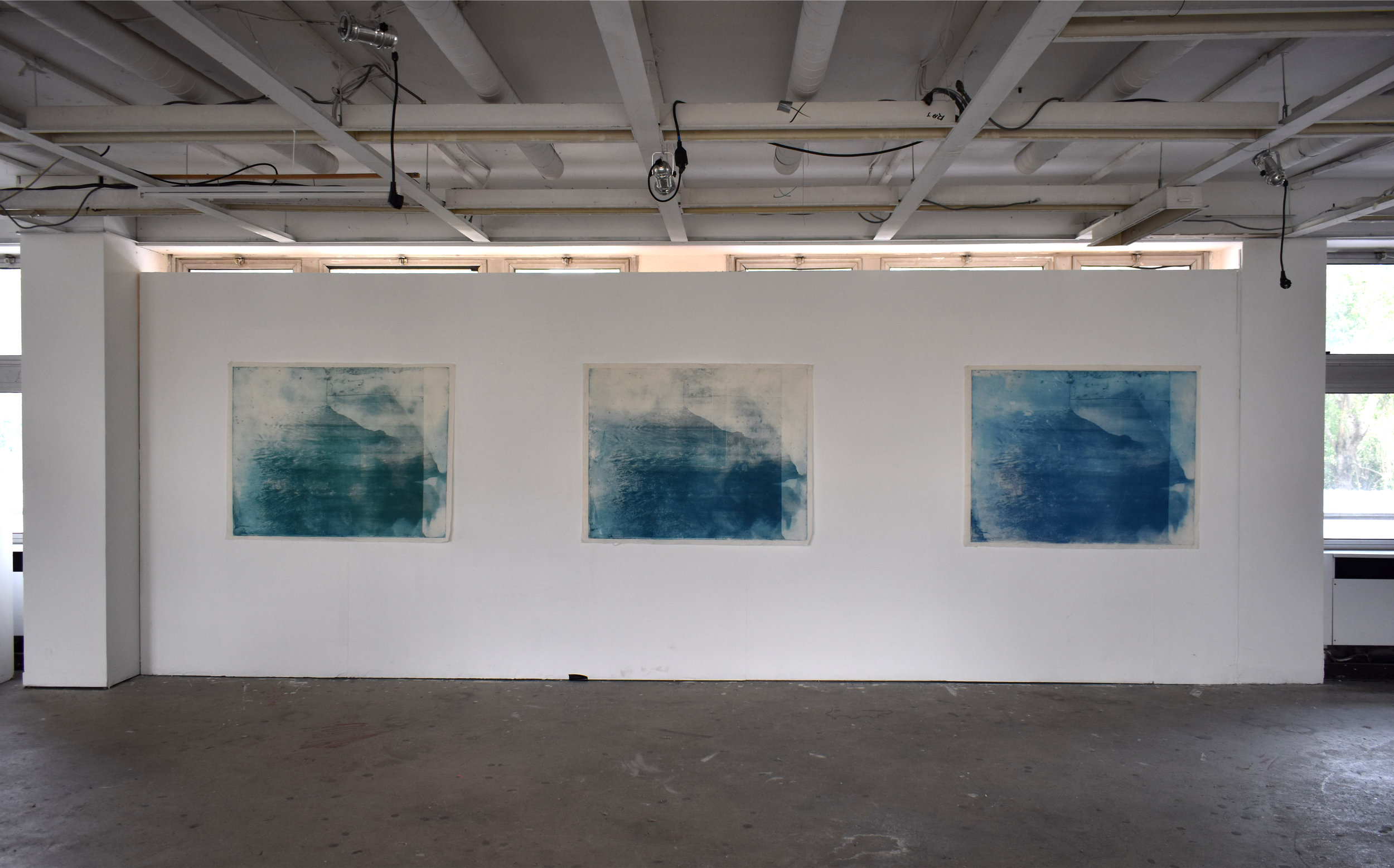 Over and Under (Whirlpool),  No. 3-6, 2019, series of 9 photopolymer prints (from Prussian blue to orange oxide) printed on semi-transparent Thai paper. 137 x 109cm each. Superposition of 2 photographs taken by the artist: fumerole pits in Námafjall, Iceland and a whirlpool off the Cap Fréhel, France. Installation shot at Le 6b, Saint-Denis, France.