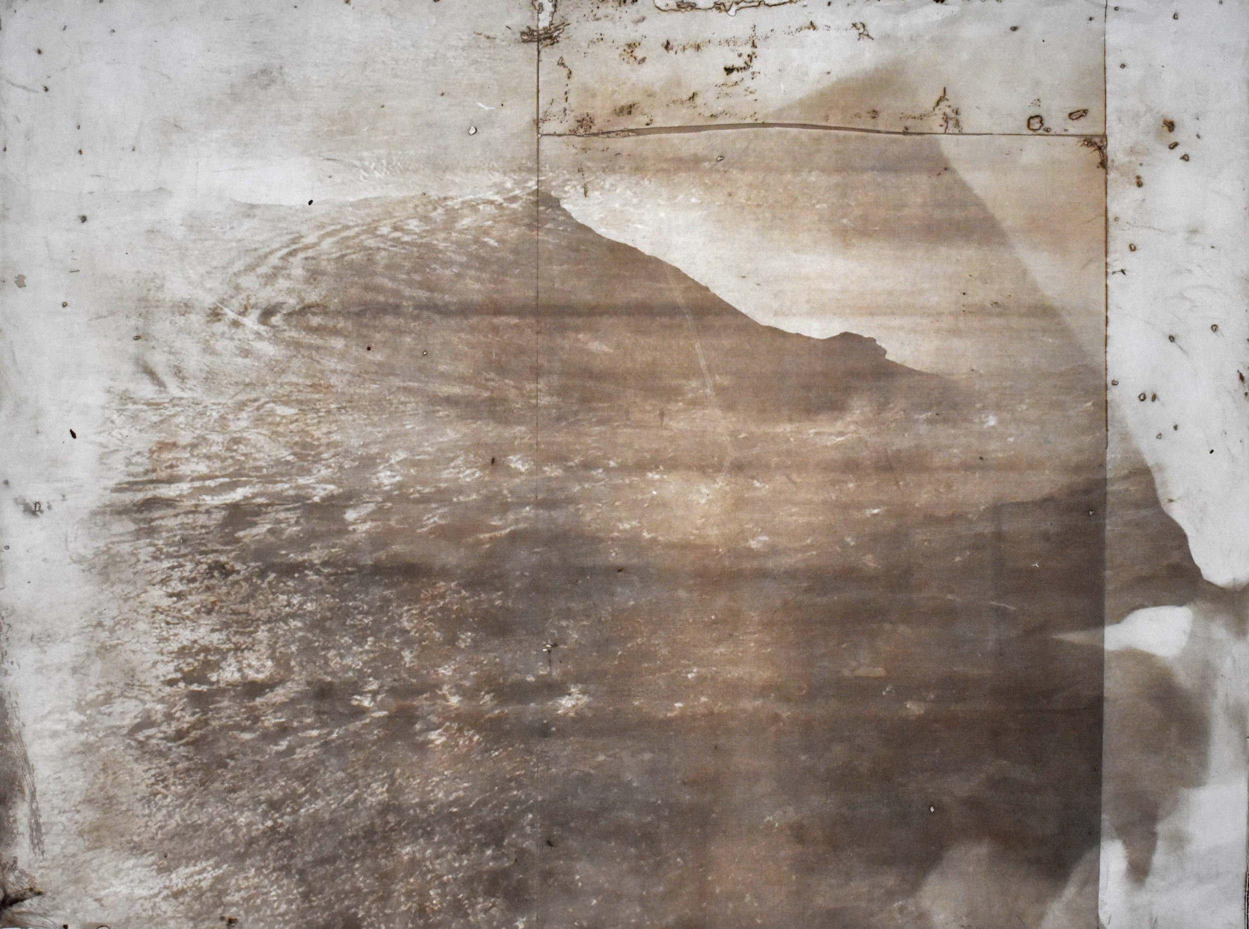 Over and Under (Whirlpool),  No. 9, 2019. Series of 9 photopolymer prints (from Prussian blue to orange oxide) printed on semi-transparent Thai paper. 137 x 109cm.. Superposition of 2 photographs taken by the artist: fumerole pits in Námafjall, Iceland and a whirlpool off the Cap Fréhel, France.