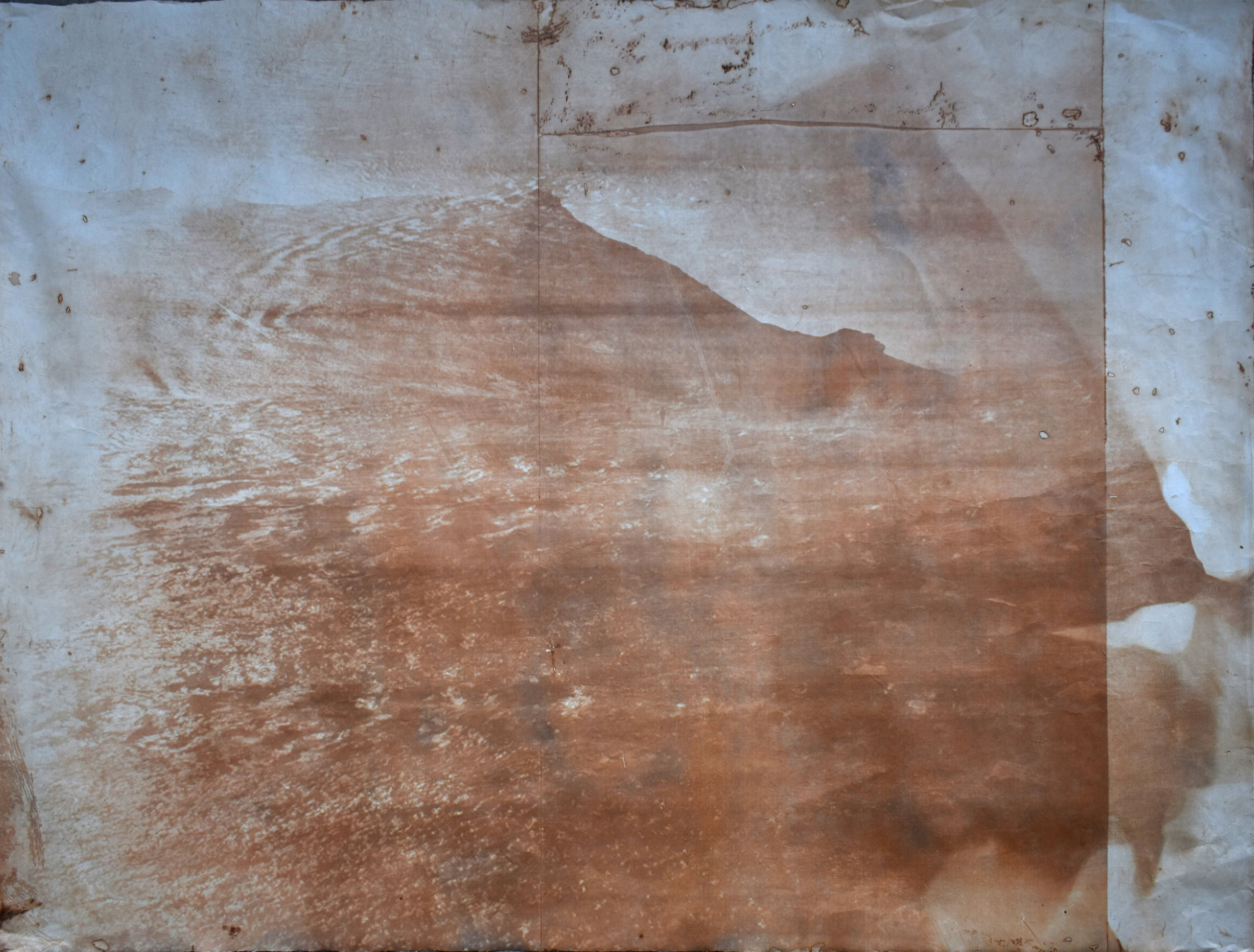 Over and Under (Whirlpool),  No. 11, 2019. Series of 9 photopolymer prints (from Prussian blue to orange oxide) printed on semi-transparent Thai paper. 137 x 109cm.. Superposition of 2 photographs taken by the artist: fumerole pits in Námafjall, Iceland and a whirlpool off the Cap Fréhel, France.