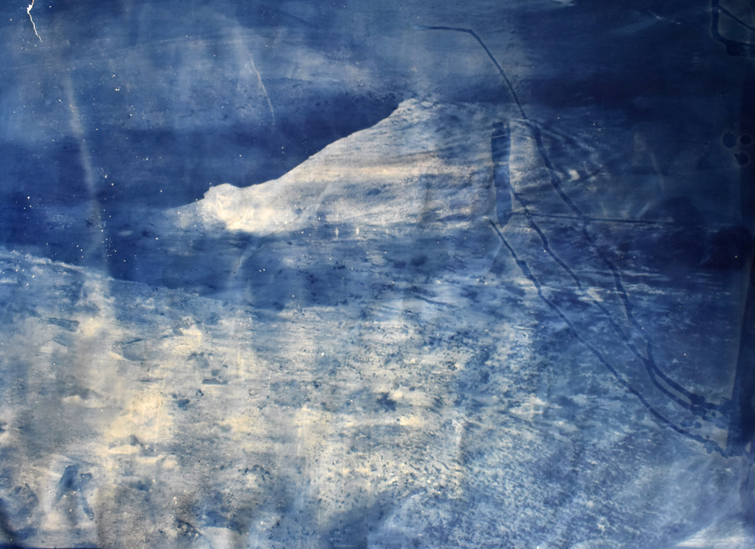 Over and Under (Whirlpool).  Cyanotype, 137cm x 109cm. Superposition of 2 photographs taken by the artist: fumerole pits in Námafjall, Iceland and a whirlpool off the Cap Fréhel, France.