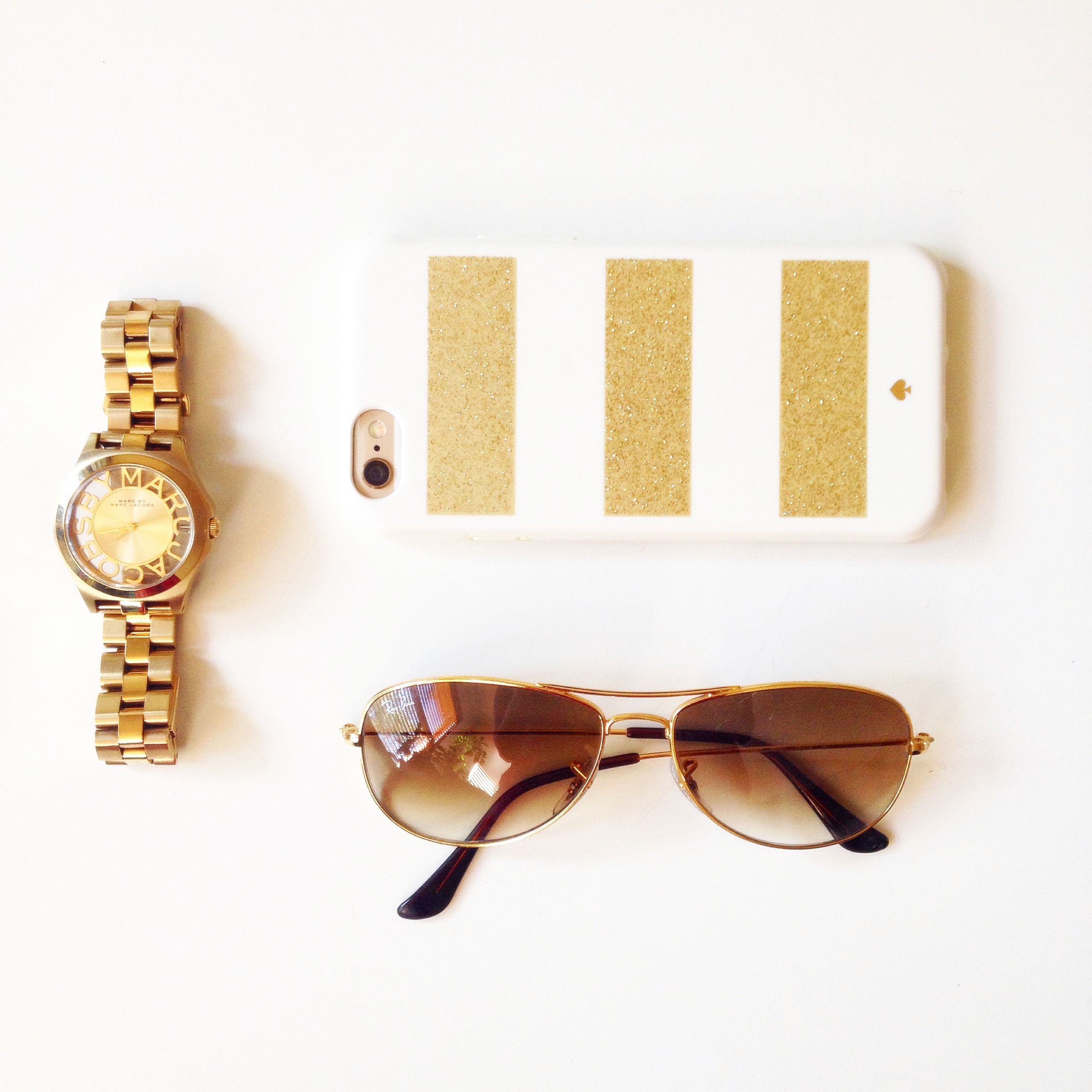 Marc Jacobs watch, Iphone 6, Ray Ban Sunglasses