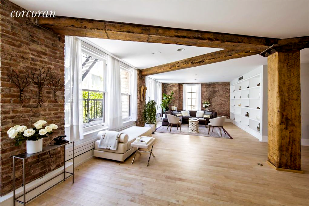 The definitive Soho loft on Wooster Street with the original hand-hewn wood beams that run throughout the entire space create the focal point with the original brick walls in a supporting role. A mix of the client's existing furniture and newly sourced items include chairs from Homenature and a CB2 daybed to create an open seating area for large gatherings.