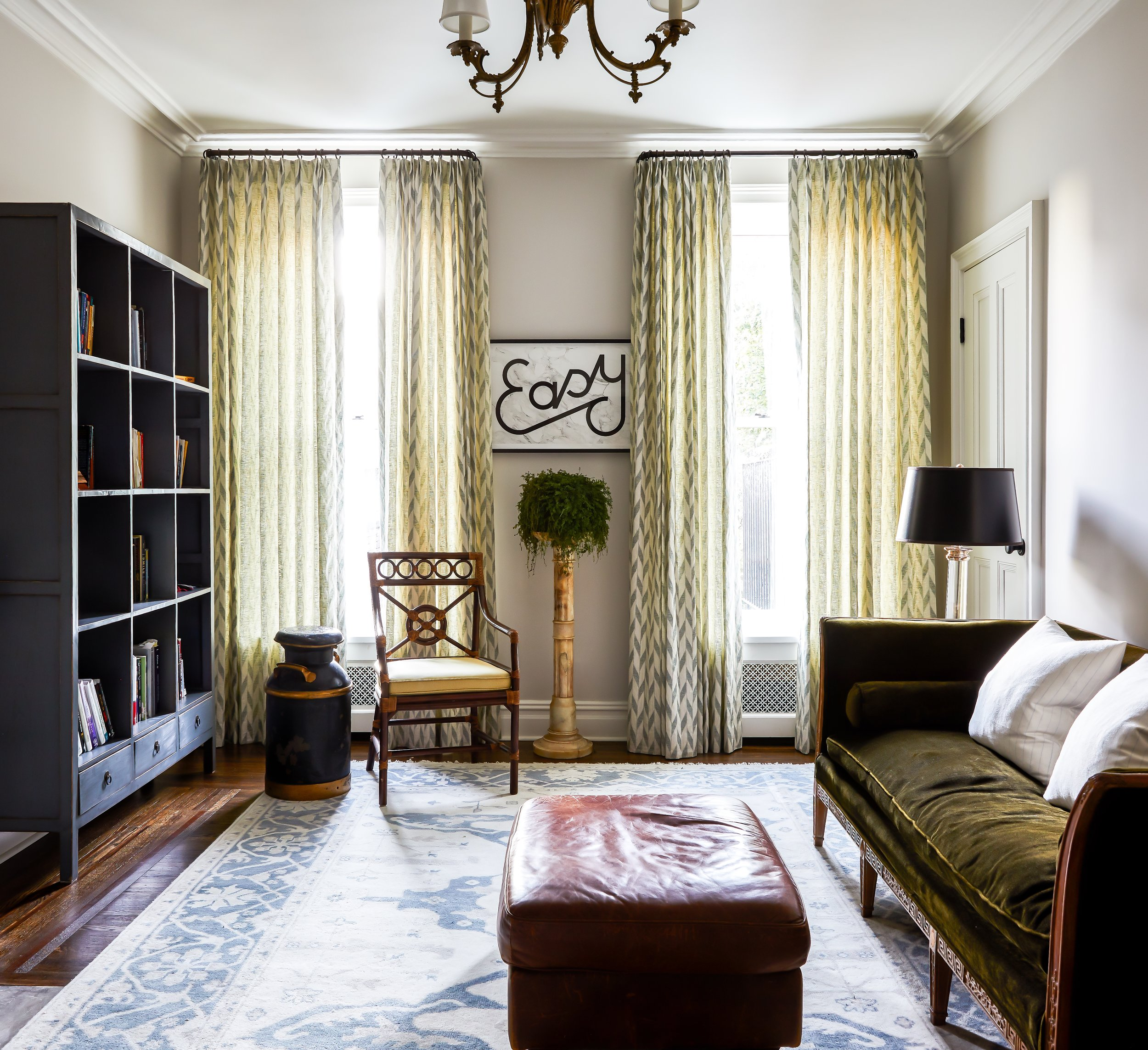 The Sitting Room in the Master Suite that encompasses the entire 3rd floor in a Brooklyn townhouse featured in House Beautiful. An antique wood trimmed sofa in a cotton velvet with a blue hand painted bookcase from England. Custom window treatments by Genesis Upholstery in a Rose Tarlow glazed linen and a vintage bamboo chair from The Antique & Artisan Gallery in Stamford, Connecticut.
