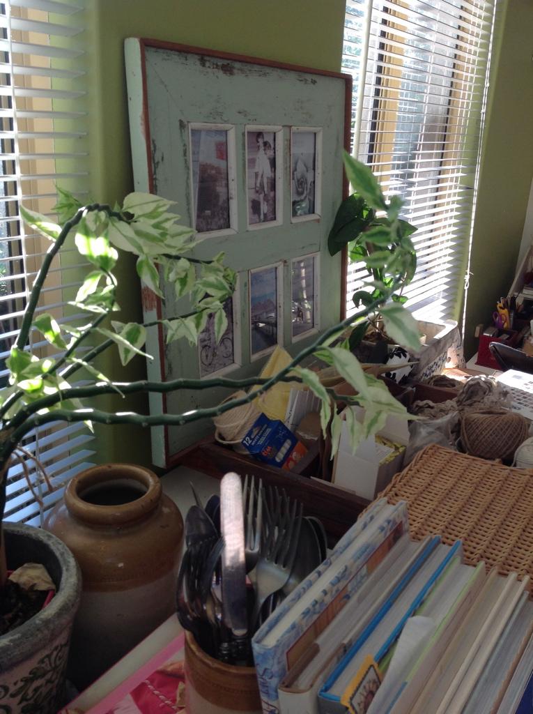 Antique Cutlery amidst plants & books my Studio work bench