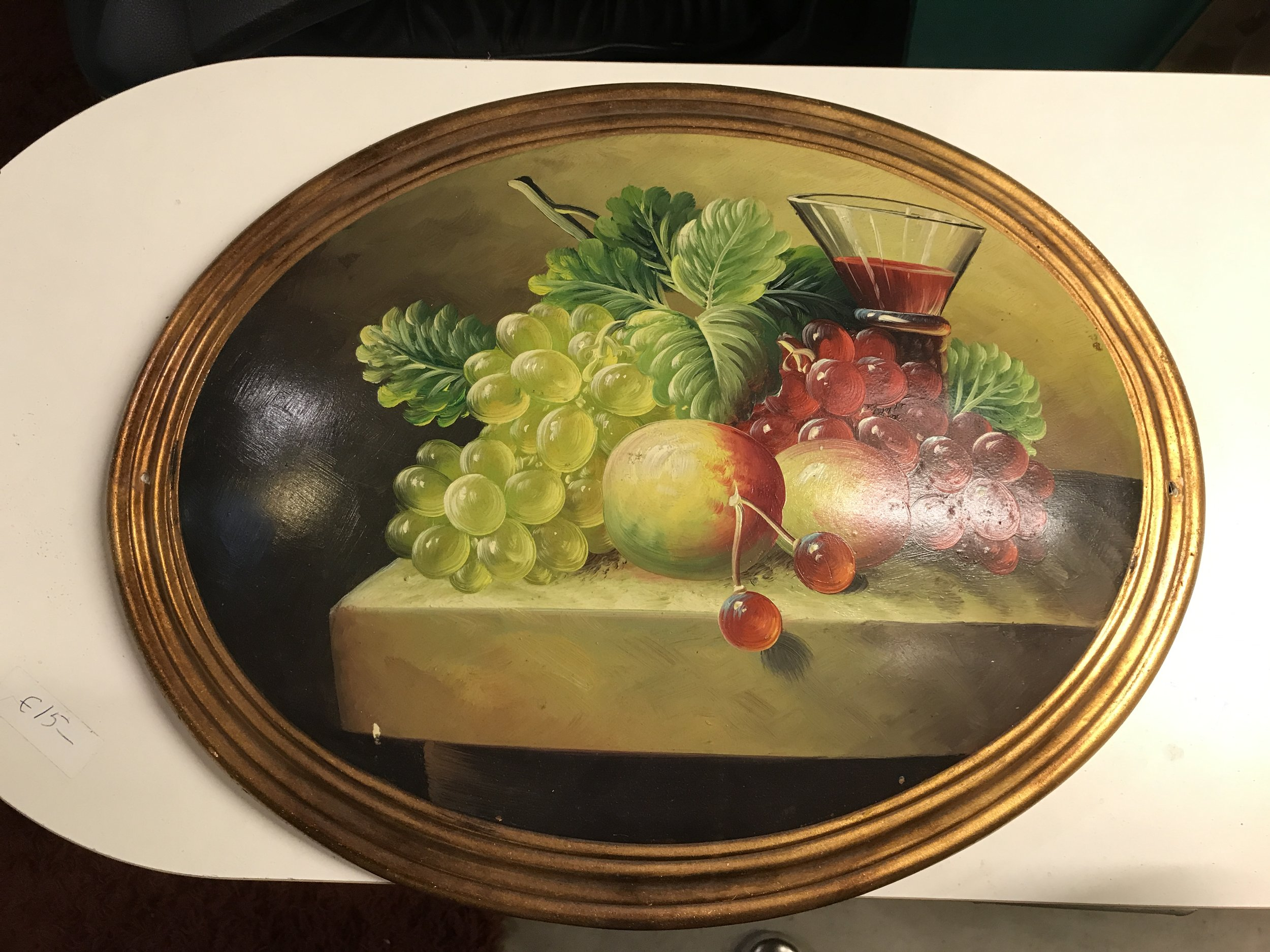 Gorgeous old paintings that are padded underneath to give the curved finish along with a satin seal.