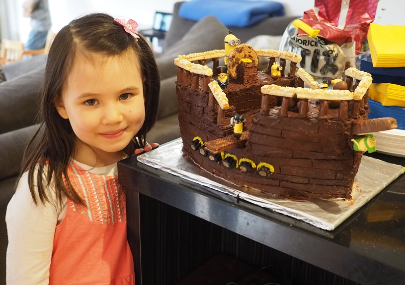 Gorgeous Erin with the minion pirate ship cake that her amazing mummy made her!!
