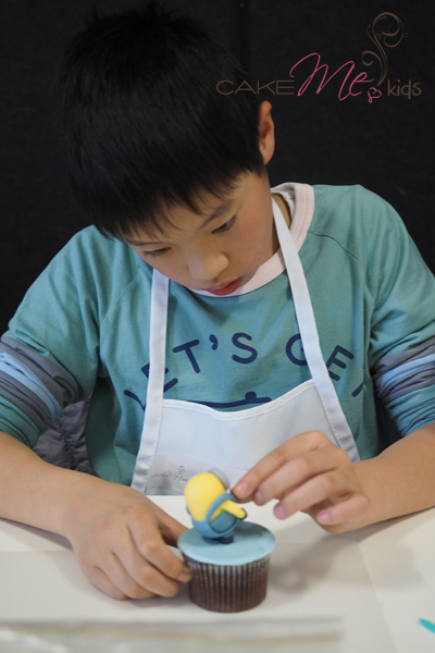 An eleven year old concentrating hard on perfecting his minion