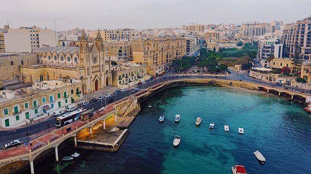 Early morning drone flight above Balluta Bay Malta