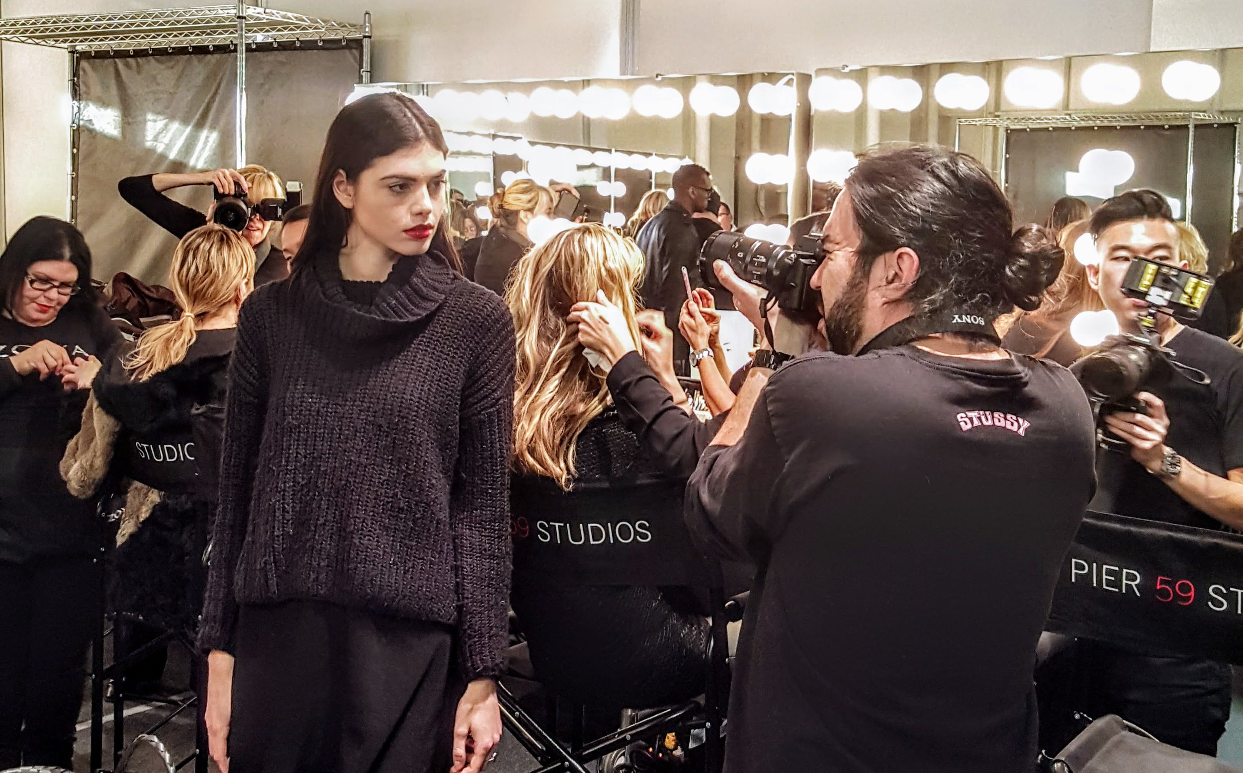 A popping red lip and natural make-up allowed for Zang Toi's FW collection to stand out.