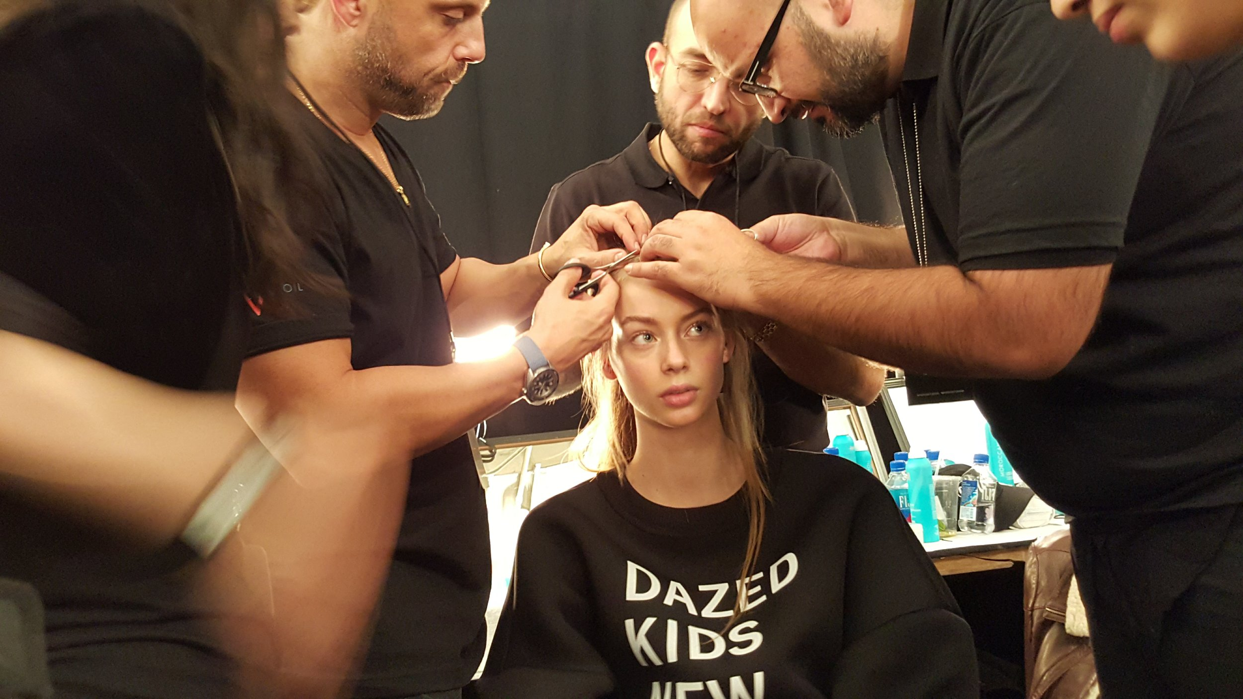This model arrived to the show with a type of dreadlocked 'do, which the Moroccan Oil team was scrambling to remove, in able to create the soft hairstyle for this show.