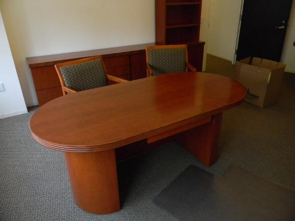 "N9 - Modern executive office set.  36"" x 72"" Oval desk with pencil drawer.  2: 2dr lateral file with bookcase hutch, 7' storage credenza and 48"" round table"