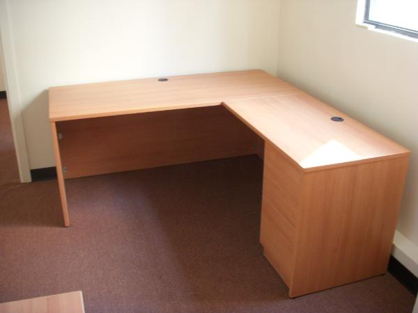 Laminate Desk in Honey Maple finish.